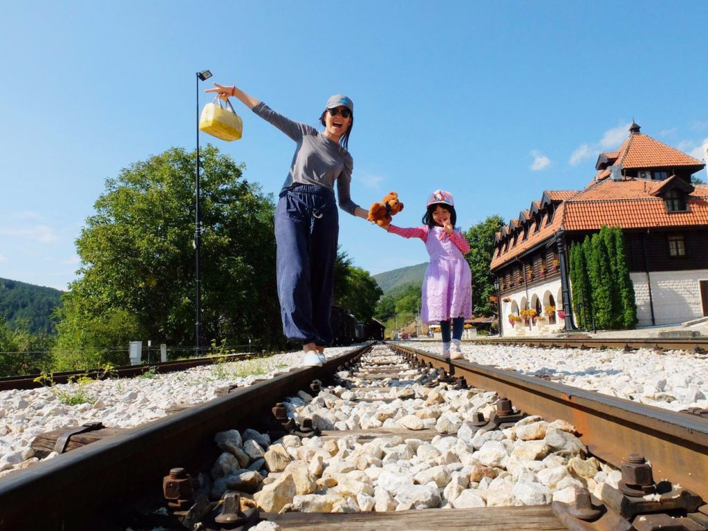 mum and daughter on train track