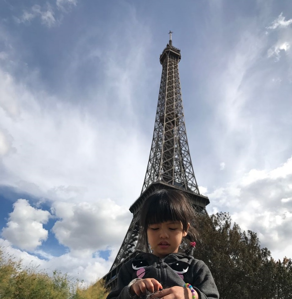 girl under Eiffel Tower