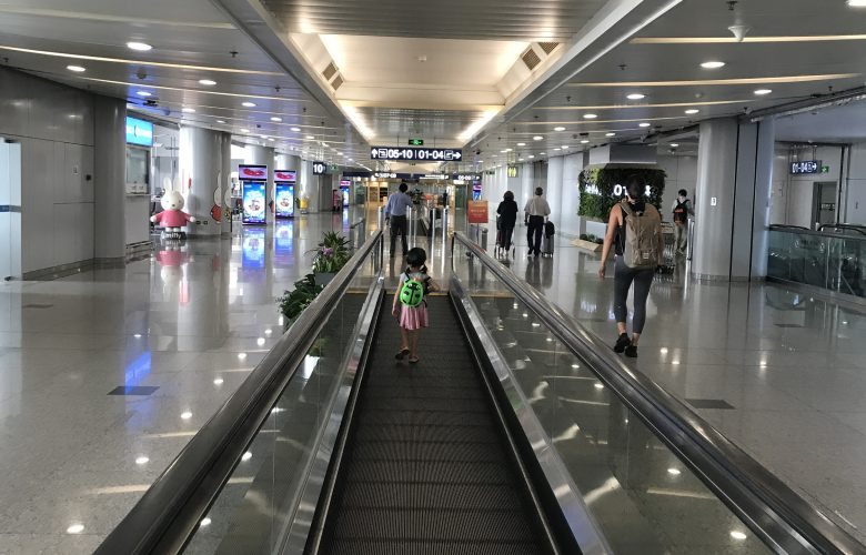 little girl walking in the airport