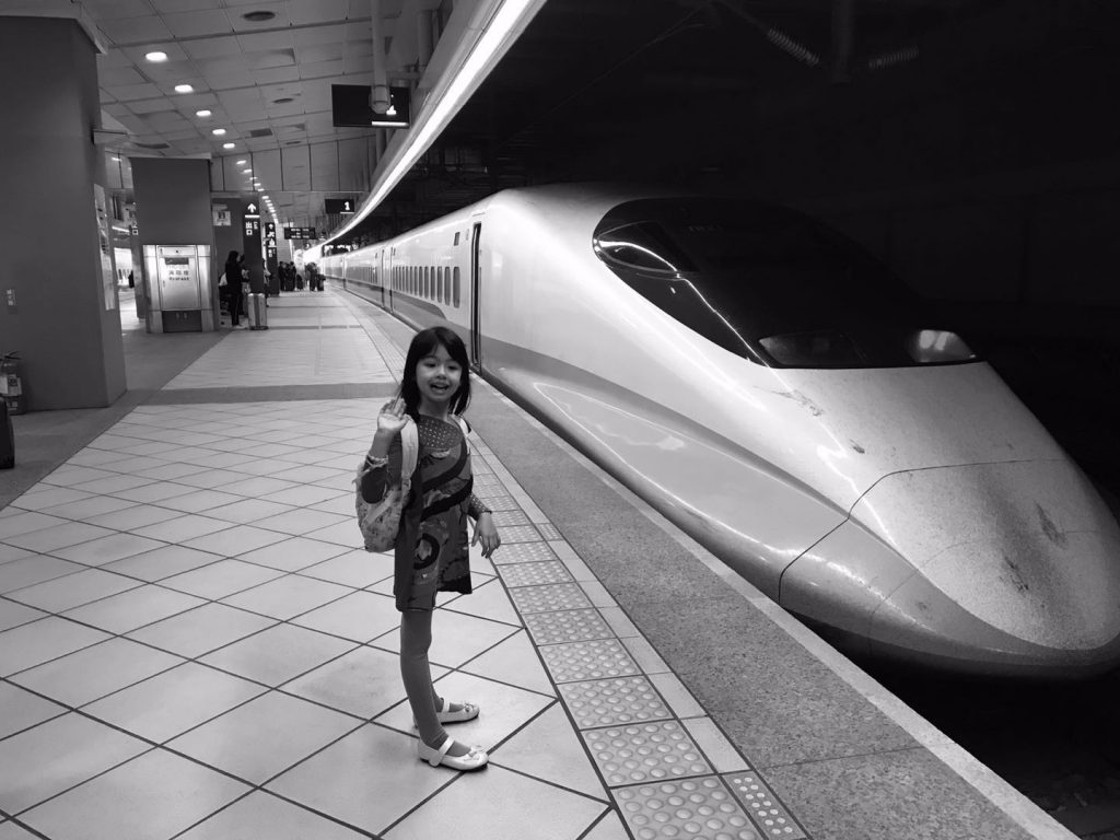 little girl by the high speed train